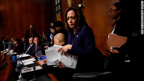 "WASHINGTON, DC - SEPTEMBER 28: Sen. Kamala Harris (D-CA) packs her belongings as she walks out of a Senate Judiciary Committee meeting due to a break in ""regular order"" of the committee on September 28, 2018 in Washington, DC. The committee met to discuss and later vote on the nomination of Judge Brett Kavanaugh to the U.S. Supreme Court prior to the nomination proceeding to a vote in the full U.S. Senate. (Photo by Win McNamee/Getty Images)"