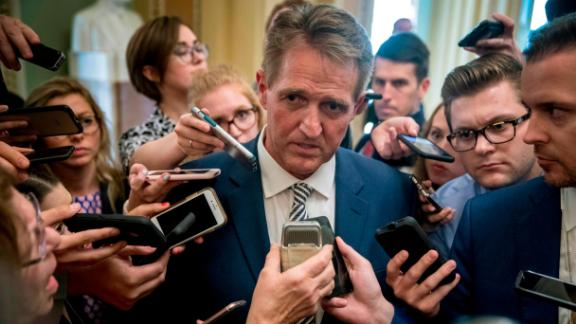 Sen. Jeff Flake, R-Ariz., center, speaks with reporters after meeting with Senate Majority Leader Mitch McConnell of Ky., in his office in the Capitol in Washington, Friday, Sept. 28, 2018. The Senate Judiciary Committee advanced Brett Kavanaugh's nomination for the Supreme Court after agreeing to a late call from Sen. Jeff Flake, R-Ariz., for a one week investigation into sexual assault allegations against the high court nominee. (AP Photo/Andrew Harnik)