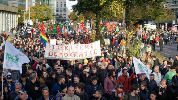 Hundreds of people gathered in Berlin Friday to demonstrate against President Erdogan and his visit to Germany.