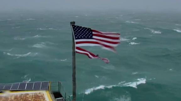 Thousands watched this scene online as the approaching hurricane battered the flag with ever-stronger winds.