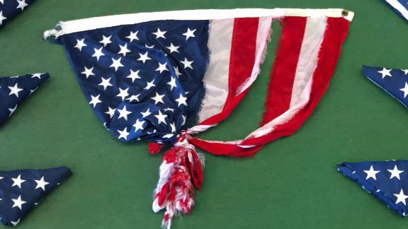 The torn flag is seen safely inside the tower.