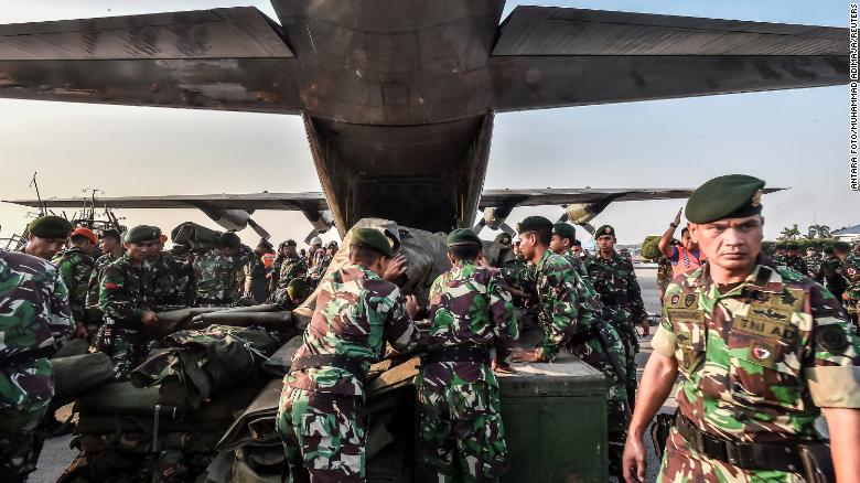 Indonesian soldiers load emergency supplies onto a military plane at Halim Perdanakusuma base in Indonesia's capital, Jakarta, on September 29 before heading to Palu.