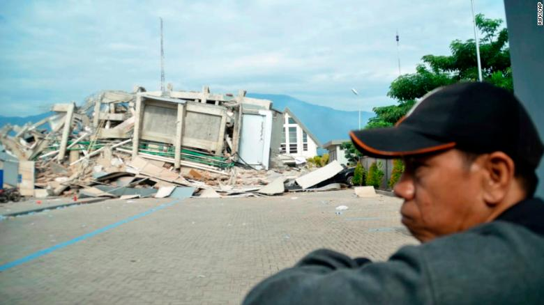 A man takes in the damage September 29 in Palu.