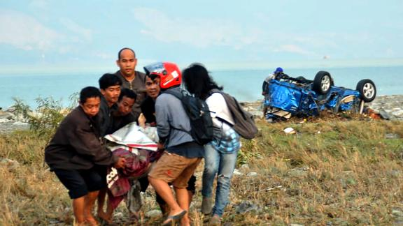 People carry a victim in Palu on September 29.