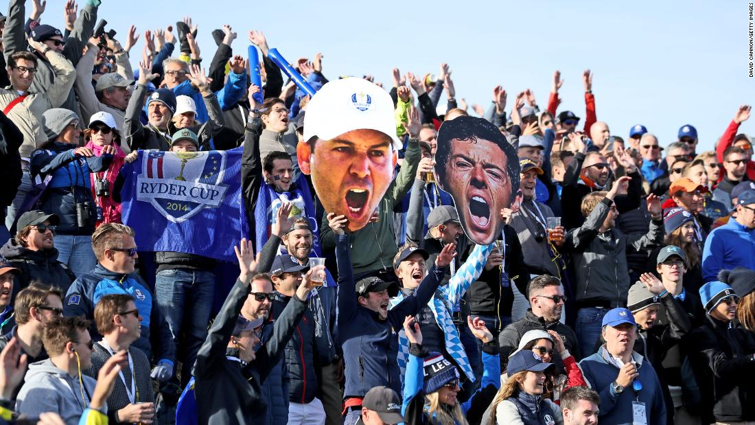 European fans display giant pictures of Rory McIlroy and Sergio Garcia during the Saturday morning four-ball matches.