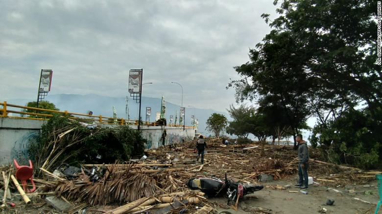 The disaster has left buildings in ruins, cut power and covered roads in debris in Palu on September 29.