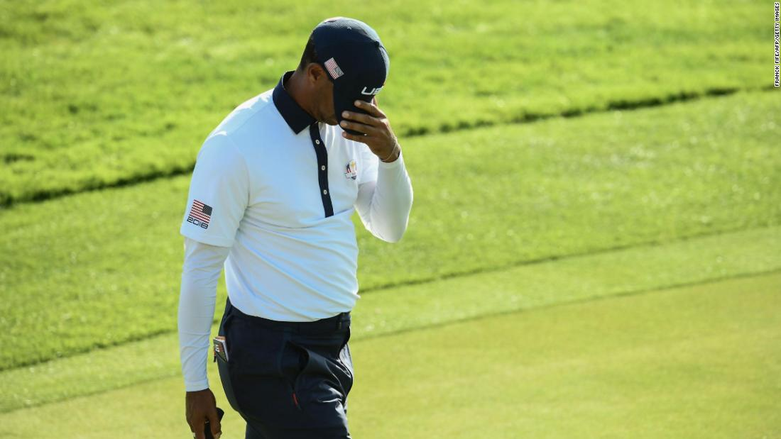 Tiger Woods reacts after losing his foursomes match on Day Two of the Ryder Cup on Saturday.
