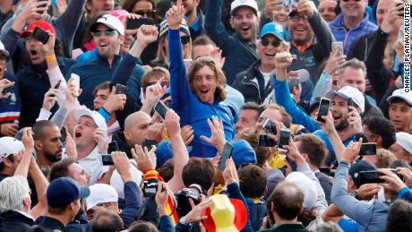 Team Europe's Tommy Fleetwood celebrates with spectators after winning the Ryder Cup in France.