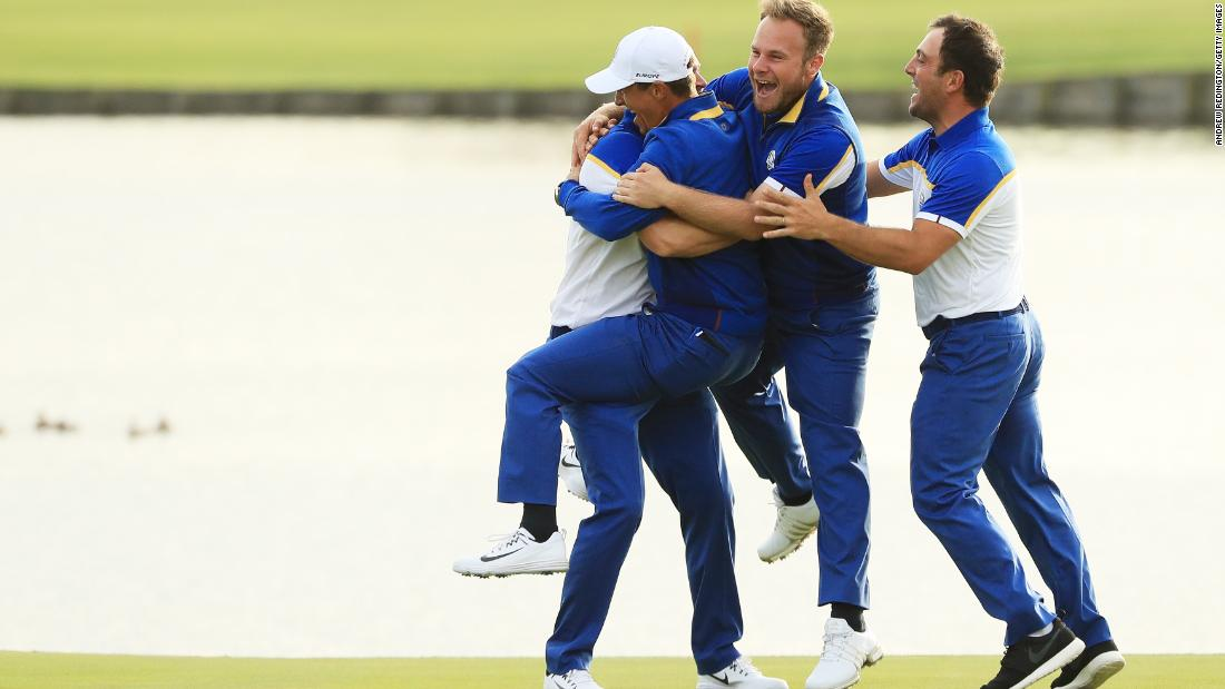 Alex Noren of Europe celebrates with his teammates after winning his match on the 18th green. Europe won the Ryder Cup, defeating the US team on Sunday, September 30 in Paris, France.