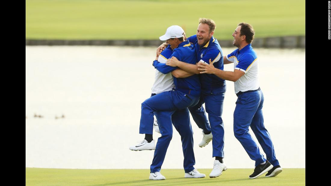 Golfer Alex Noren of Europe celebrates with his teammates after winning the match on the 18th green. Europe won the Ryder Cup, defeating the US team on Sunday, September 30, in Paris.