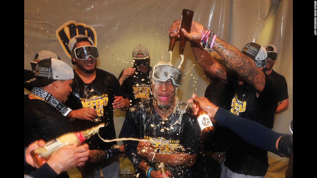 Keon Broxton of the Milwaukee Brewers is doused by his teammates as they celebrate beating the St. Louis Cardinals and clinching a Major League Baseball playoff berth on Wednesday, September 26, in St. Louis.