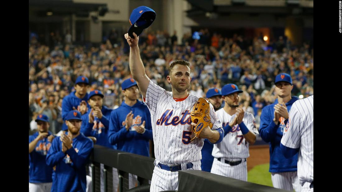 New York Mets third baseman David Wright acknowledges the crowd as he comes out of the final baseball game of his career during the fifth inning on Saturday, September 29, in New York. The 35-year-old received a standing ovation from his fans.