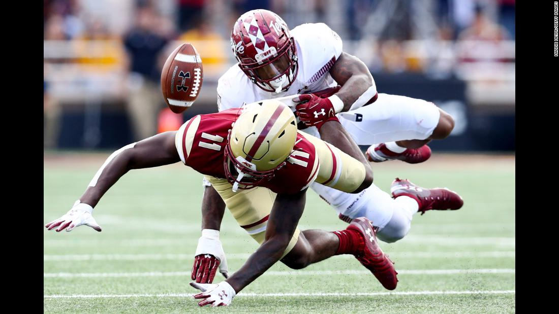 CJ Lewis of the Boston College Eagles is tackled by Chapelle Russell of the Temple Owls during the second half of the football game on Saturday, September 29, in Chestnut Hill, Massachusetts.