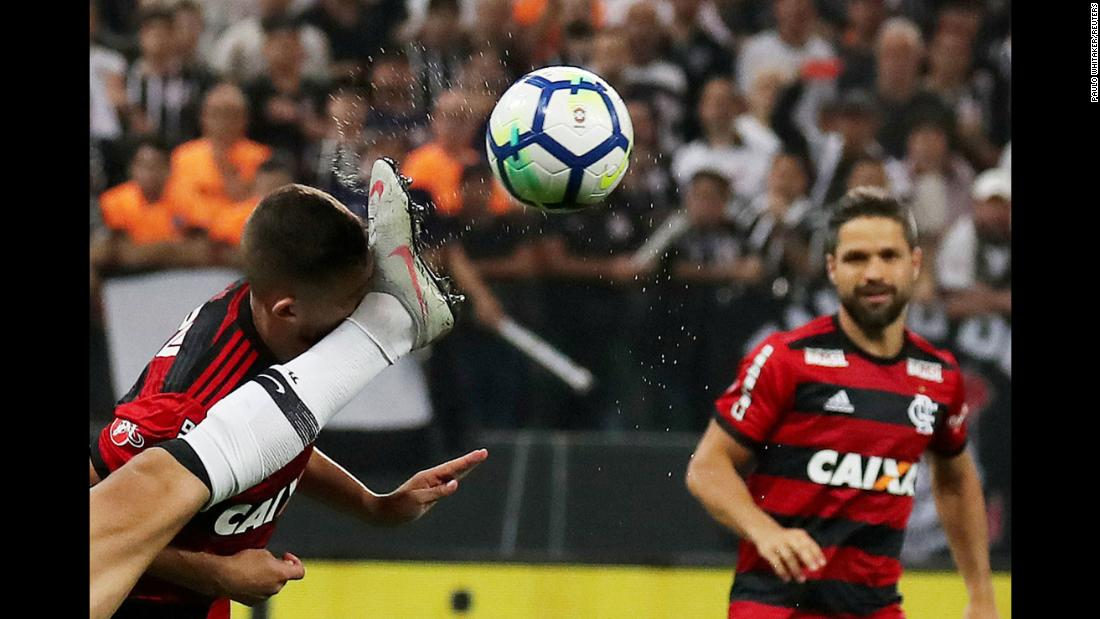 Corinthians' Douglas Augusto gets a leg in the face as he goes for the ball in the Copa Do Brasil soccer semifinals on Wednesday, September 26. The Corinthians defeated Flamengo 2-1.