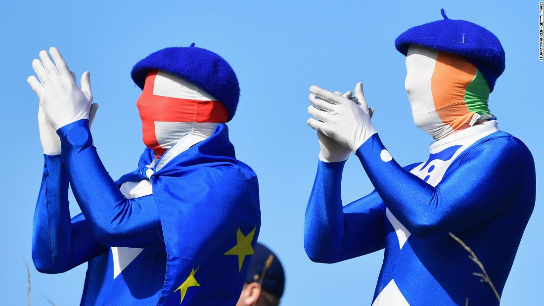 European fans applaud on Saturday, September 29, during the foursome golf matches of the Ryder Cup in Paris.