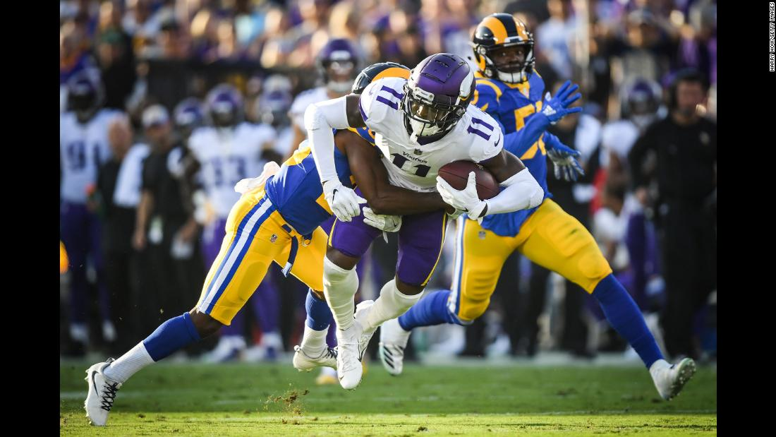 Laquon Treadwell of the Minnesota Vikings is tackled by Lamarcus Joyner of the Los Angeles Rams after his catch in the first quarter of football on Thursday, September 27, in Los Angeles.