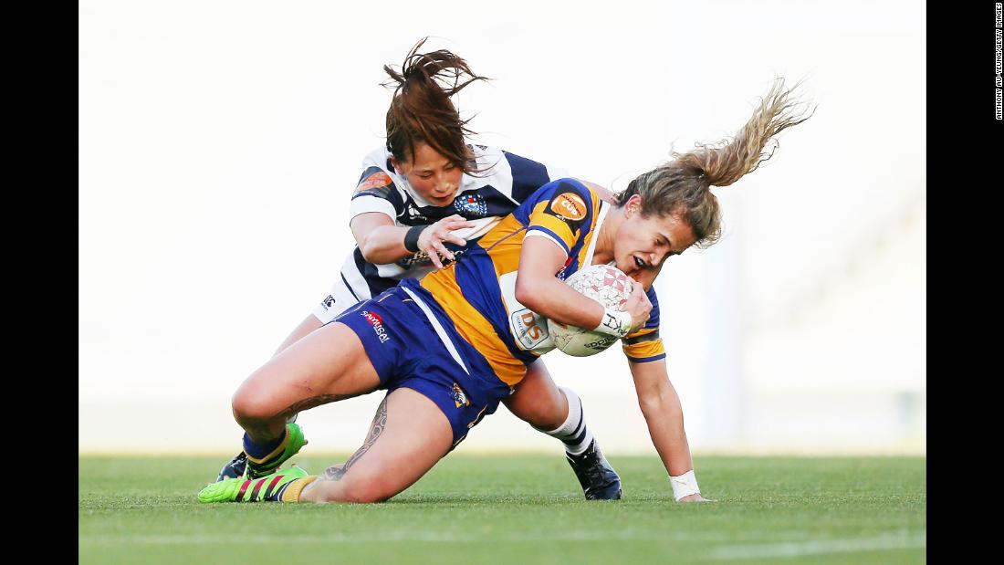 Hana Tapiata of Bay of Plenty is tackled by Misaki Suzuki of Auckland during a Farah Palmer Cup rugby match on Friday, September 28, in Auckland, New Zealand.