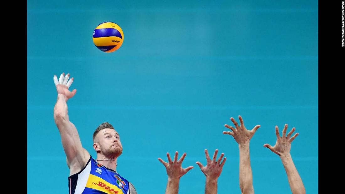 Italy's Ivan Zaytsev hits the ball during a  match against Poland in the Volleyball World Cup on Friday, September 28, in Turin, Italy.