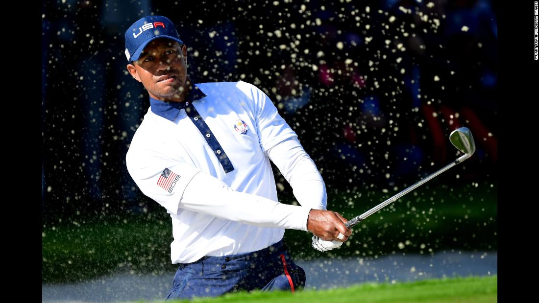 Golfer Tiger Woods of the United States plays out of a bunker during the Ryder Cup foursomes matches on Saturday, September 29, in Paris.