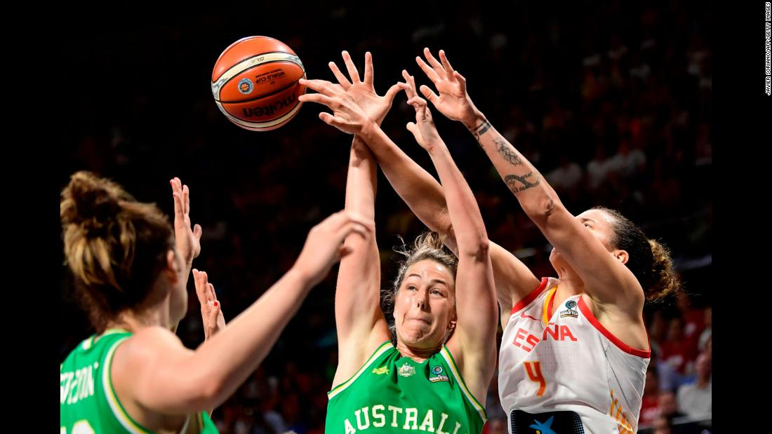 Australia guard Jenna O'Hea vies with Spain forward Laura Nicholls during their FIBA Women's Basketball World Cup match in San Cristobal de la Laguna, Tenerife, on Saturday, September 29.