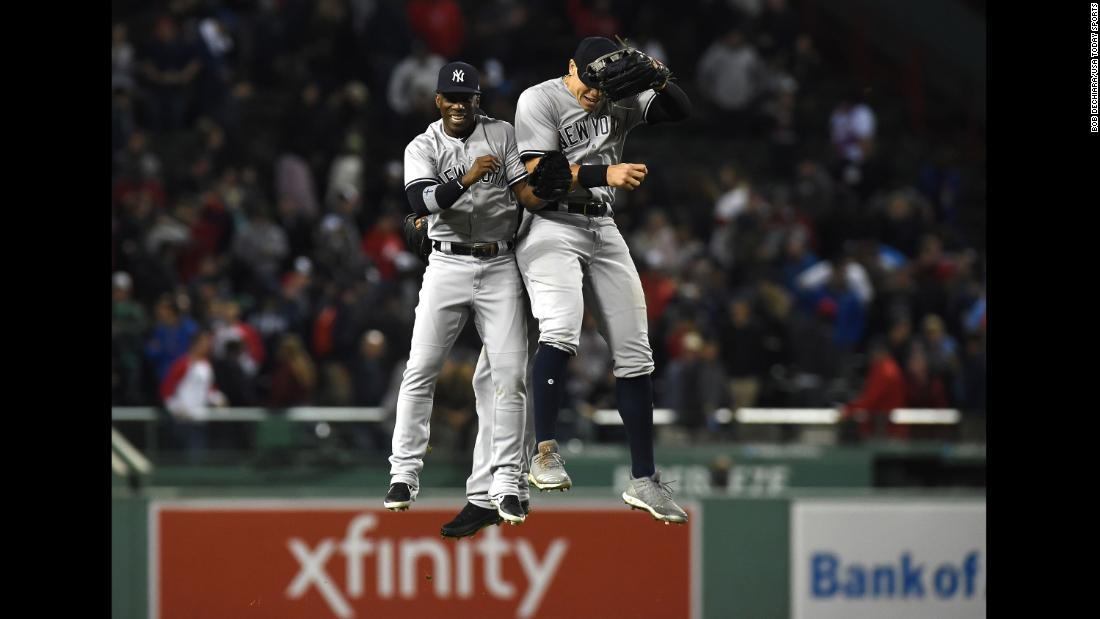 New York Yankees baseball player Andrew McCutchen celebrates with teammate Aaron Judge after defeating the Boston Red Sox on Friday, September 28, in Boston.