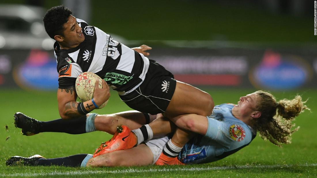 Jamie-Jerry Taulagi of Hawke's Bay is tackled by Scott Gregory of Northland during a Mitre 10 Cup rugby match on Wednesday, September 26, in Napier, New Zealand.