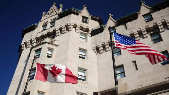 A Canadian and an American flag fly outside the Fairmont Hotels & Resorts Inc. Chateau Laurier hotel in Ottawa, Ontario, Canada, on Thursday, Aug. 16, 2018. It makes sense for the U.S. and Mexico to meet bilaterally on Nafta on certain issues and Canada looks forward to rejoining talks on the trilateral pact in the coming days and weeks, Prime Minister Justin Trudeau said. Photographer: Brent Lewin/Bloomberg via Getty Images