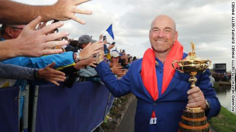 Captain Thomas Bjorn holds the Ryder Cup as the European team celebrates at Le Golf National in Paris in September.
