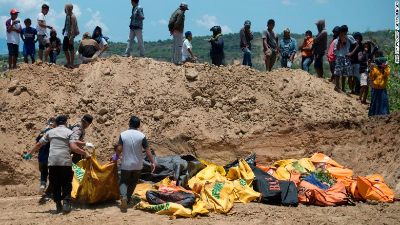 Body bags lie in an open ditch in Palu, Indonesia.
