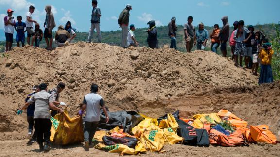 Body bags lie in an open ditch in Palu, Indonesia.