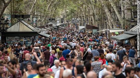 BARCELONA, SPAIN - AUGUST 19: Locals and tourists walk along Las Ramblas as life returns to normal following Thursday's terrorist attack, on August 19, 2017 in Barcelona, Spain. A nationwide manhunt continues for Younes Abouyaaqoub, now named by Spanish media as the suspected driver in an attack that left thirteen people dead and dozens injured when a van was driven at crowds in the popular Las Ramblas area of Barcelona on Thursday.  (Photo by Carl Court/Getty Images)