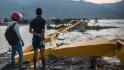 Mass graves and destruction after Indonesia tsunami