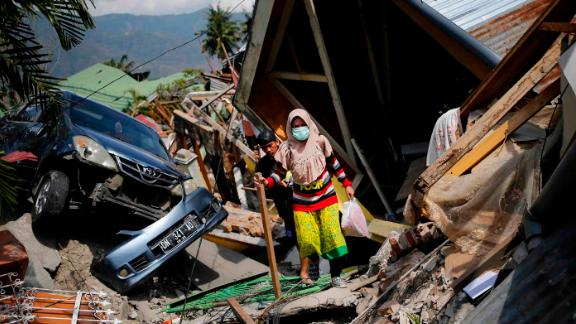 A woman makes her way through rubble in the Palu neighborhood of Balaroa on October 2.