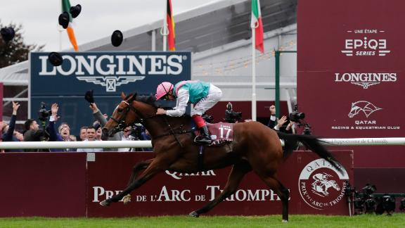 Jockey Frankie Dettori, on his horse Enable, races to win the 96th Qatar Prix de l