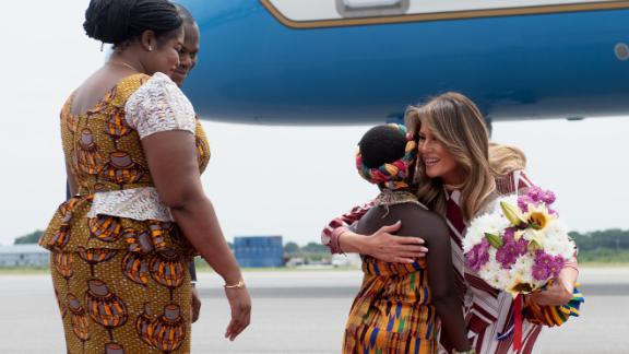 Melania Trump receives flowers during an arrival ceremony after landing at Kotoka International Airport in Accra, Ghana, on Tuesday.