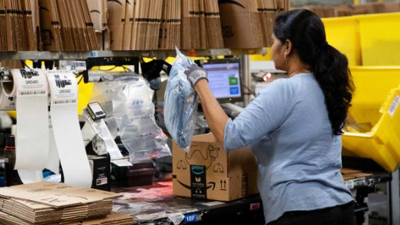 An employee packs a box at the Amazon fulfillment center in Robbinsville, New Jersey.