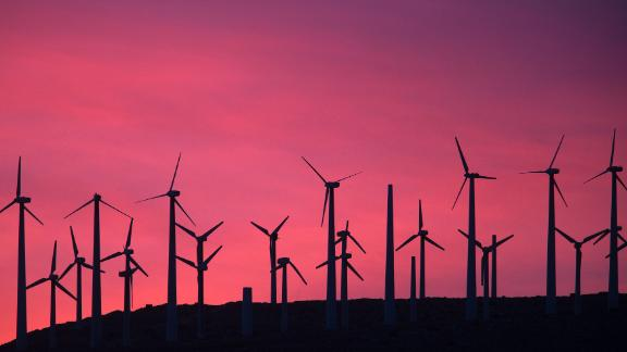 TOPSHOT - Electric energy generating wind turbines are seen on a wind farm in the San Gorgonio Pass area on Earth Day, April 22, 2016, near Palm Springs, California.  San Gorgonio Pass is one of the largest wind farm areas in the United States.  / AFP / David McNew        (Photo credit should read DAVID MCNEW/AFP/Getty Images)