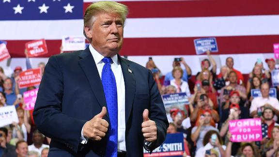 """US President Donald Trump arrives at a """"Make America Great Again"""" rally at Landers Center in Southaven, Mississippi, on October 2, 2018. (Photo by MANDEL NGAN / AFP)        (Photo credit should read MANDEL NGAN/AFP/Getty Images)"""