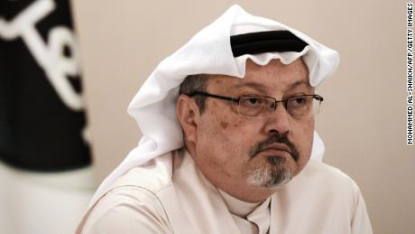 Jamal Khashoggi looks on during a news conference in Bahrain on December 15, 2014.