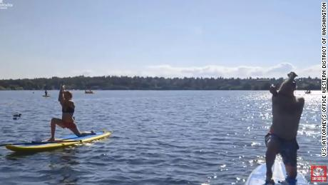 Paul LaMarche performs yoga on a paddleboard, right, while collecting disability.
