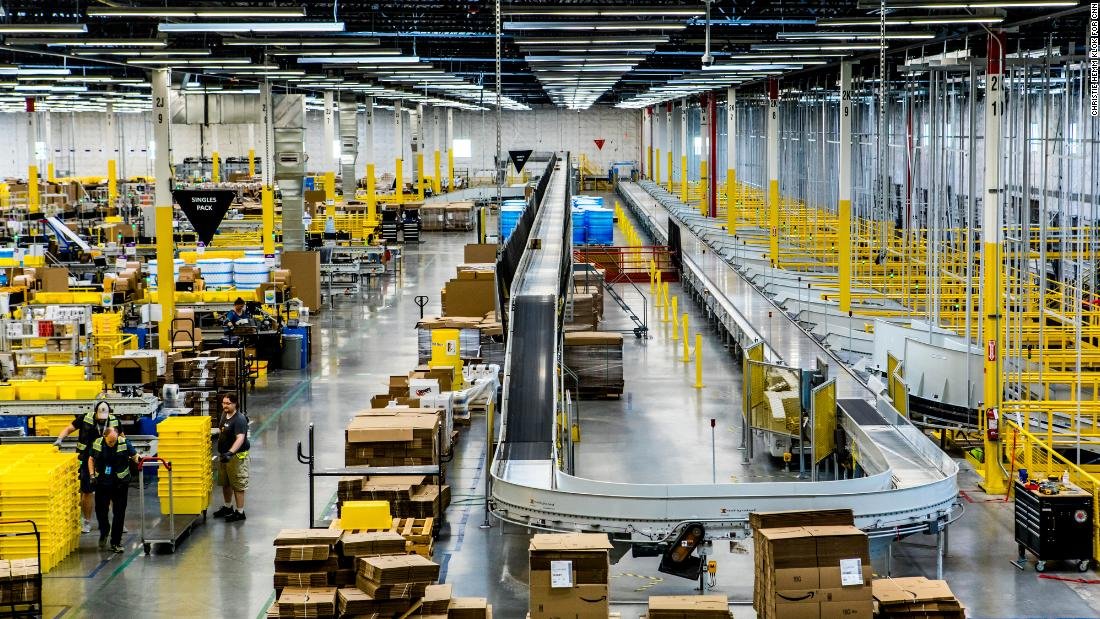 Inside an Amazon fulfillment center, a conveyer belt is used to organize packages.