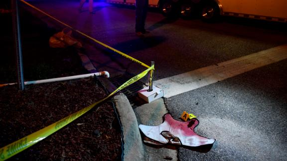 Blood-soaked evidence lies on the ground after officers were shot Wednesday in Florence.