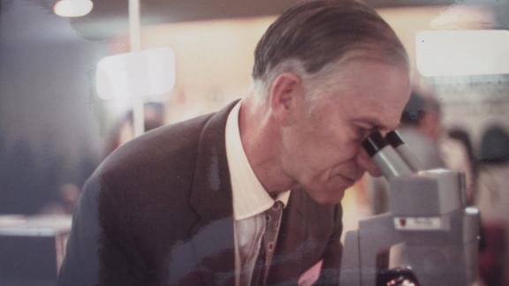 Frankland with his microscope.
