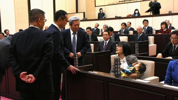 Lawmaker Yuka Ogata was forced to leave a Kumamoto city council session in 2017 after she tried to bring her infant son in with her.