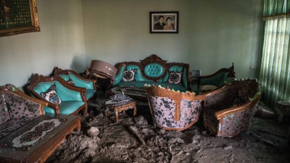 Furniture sits partially submerged in mud in a Palu house on October 4.