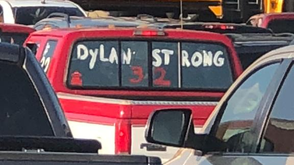 Cars honor Dylan Thomas' jersey number at his funeral.