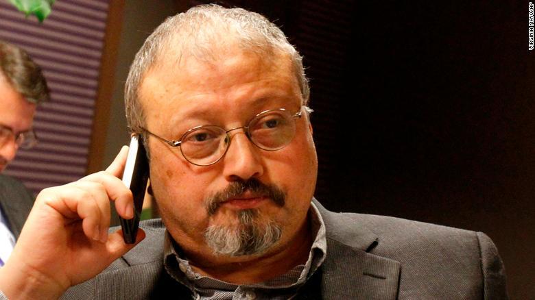 In this Jan. 29, 2011, file photo, Saudi Arabian journalist Jamal Khashoggi speaks on his cellphone at the World Economic Forum in Davos, Switzerland.