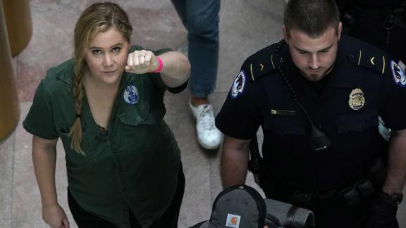 Amy Schumer is led away after she was arrested during a protest against Judge Brett Kavanaugh.