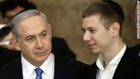 A file photo from March 2015 of Israeli Prime Minister Benjamin Netanyahu (L) and his son Yair.