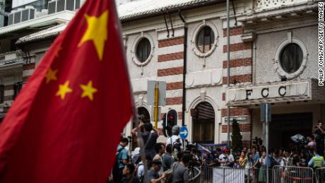 A Chinese flag is seen as Pro-Beijing protesters and members of the media gather outside the HK Foreign Correspondents' Club (FCC) before Andy Chan's speech on August 14, 2018.